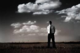 Blindfolded man in field